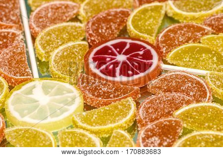 Colorful sugary marmalade like lemon and orange slices with handmade lollipop candies. Dolce vita.