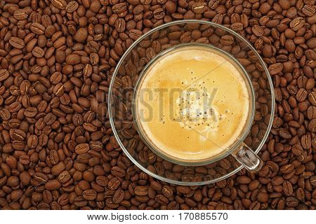 Full Latte Glass Transparent Cup On Coffee Beans