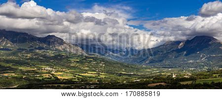 Panoramic summer view on the Champsaur Valley (Chabotte Plain) with the villages of Saint Julien en Champsaur Saint Laurent du Cros and Saint Leger les Melezes. Hautes Alpes Southern French Alps France