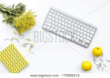 female desktop with keyboard and flowers top view mock up no one