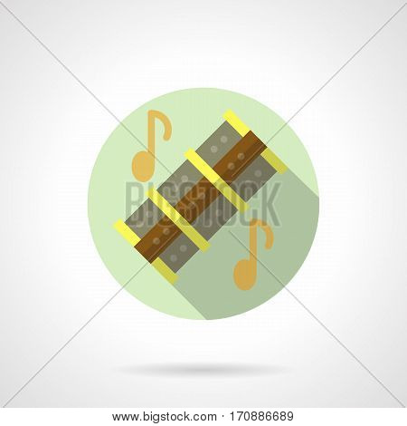 Symbol of wooden reed pipes with golden notes, long shadow design. Chinese traditional woodwind musical instruments. Stylish round flat color vector icon.