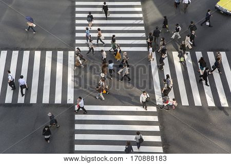 High Angle Of People Across The Crosswalk