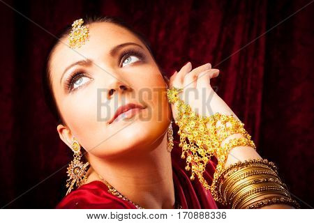 Studio shot of beautiful young woman wearing bollywood-style sari