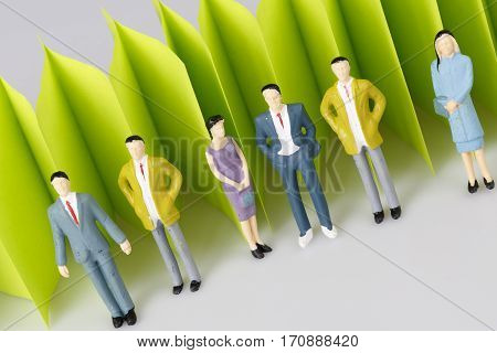 abstract green paper fence on white with group of old business people - sticky notes paper