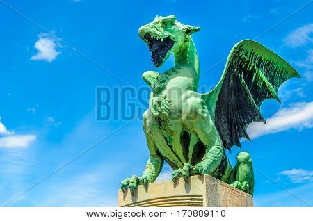 Ljubljana dragon green statue blue sky background