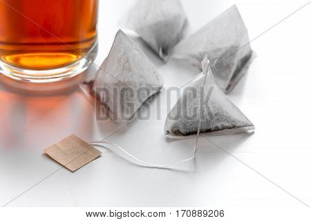 Cup of black tea with four teabags on white background mock up