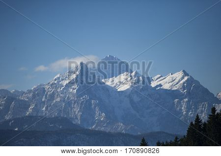 Panorama of beautiful snowy mountains on a sunny day in winter time. The highest mountain in Slovenia Julian Alps Europe.