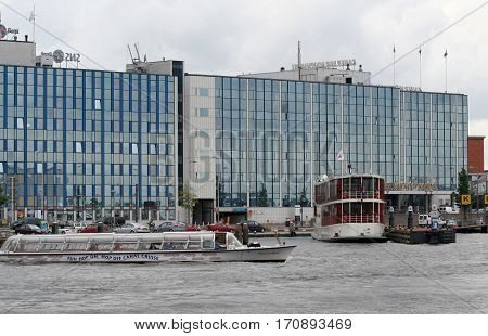 Netherlands Amsterdam june 2016: Renovated office buildings along river IJ