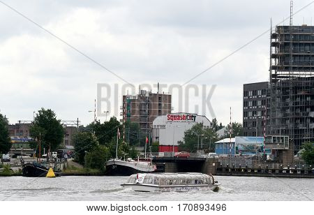 Netherlands Amsterdam june 2016: Canalboats on river IJ