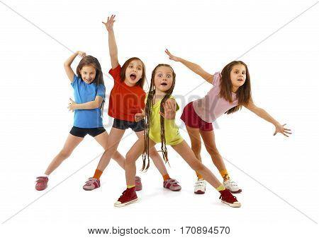 Little girls gymnasts doing exercises isolated on white