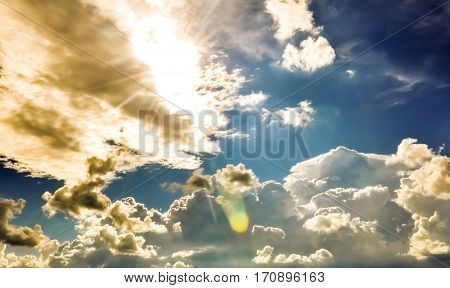 Cumulus Clouds In The Deep Blue Sky And Golden Sunshine