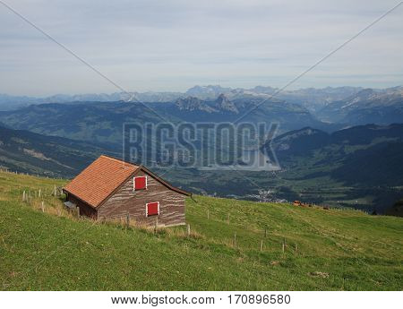 Summer day on mount Rigi. View of lake Lauerzersee and mount Mythen.