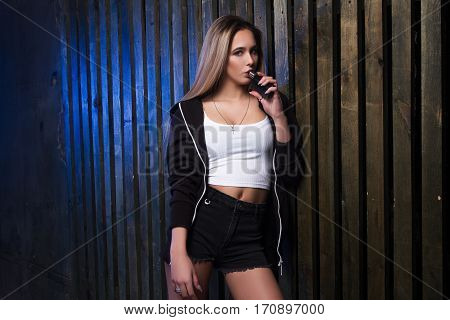 Portrait Of Sexy Young Vaping Girl. Vapor Concept.