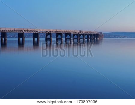Bridge on the River Tay. Dundee, Scotland - January 29, 2017 The frozen waters of the River Tay and road bridge in the Scottish city of Dundee.