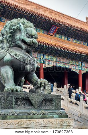 Beijing, China - Oct 30, 2016: Bronze lioness with left paw on cub symbolizes thriving and prosperous imperial family. At Gate of Supreme Harmony (Taihemen), Forbidden City (Gu Gong, Palace Museum).