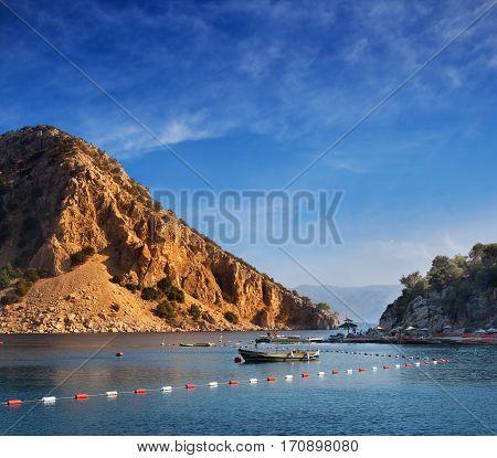Sea scape of rocky harbor in Marmaris Medeterranian Sea Turkey