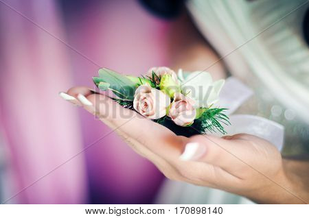 Bride Holds Wedding Bouquet in the Hands. Closeup.