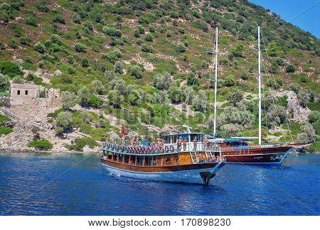 Camelia Island Turkey - 6 September 2011: Touristic boats archored by the Camellia Island in Aegean Sea. Camelia Island is very popular among tourists.