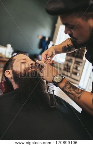Man Having A Shave At The Barber Shop