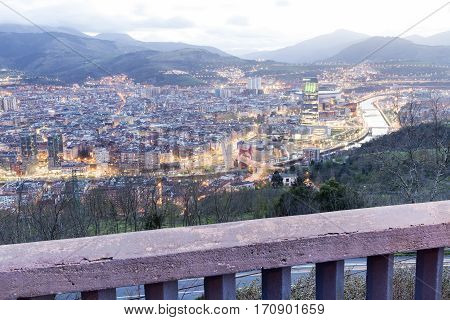 Landscape at sunset of the city of Bilbao Basque Country Spain. Panoramic with a cloudy sky.