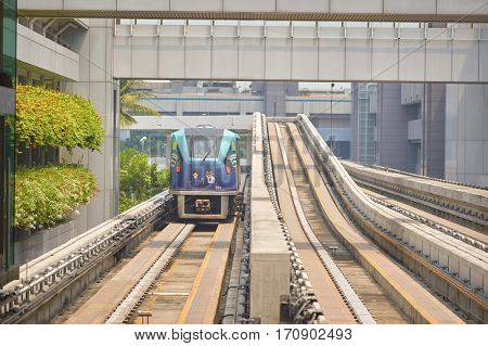 SINGAPORE - CIRCA NOVEMBER, 2015: Changi Airport Skytrain at daytime. The Changi Airport Skytrain is an automated people mover that connects Terminals 1, 2 and 3 at Singapore Changi Airport.