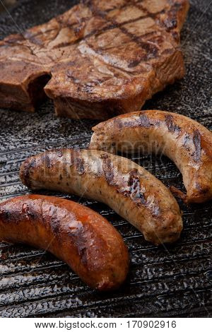 Grilled Sausages And T-bone Steak