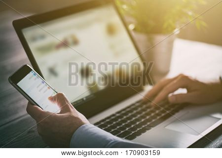 laptop computer phone business using technology office working smart internet male typing man mobile table concept - stock image