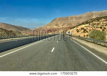 Chichaoua, Morocco, February 03, 2017: Street through the Atlas mountains at Chichaoua in Morocco.