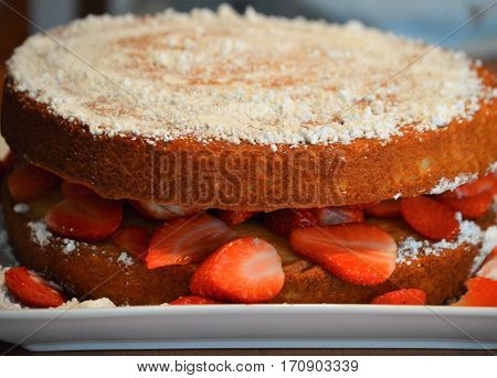 homemade strawberry short cake with confectioners sugar