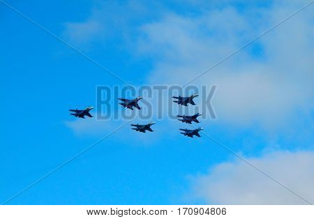 Military fighter jet during demonstration.  Aerobatic maneuvers in the sky