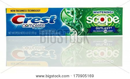 Winneconne WI - 12 February 2017: Package of Crest complete toothpaste with scope on an isolated background.