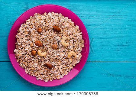 Muesli With Nuts(hazelnuts, Cashews, Almonds). Muesli On A Wooden Table. Muesli Top View . Healthy F