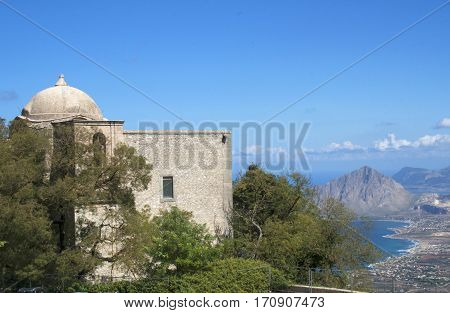 The church of St Giovani, in the town of Erice, overlooking the mountains and ocean below