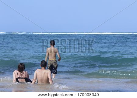 Family looking at the sea in a summer day