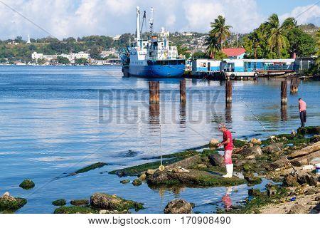 HAVANA,CUBA-FEBRUARY 5,2017 : Fishermen at the coastal town of Regla next to the capital city of Havana in Cuba