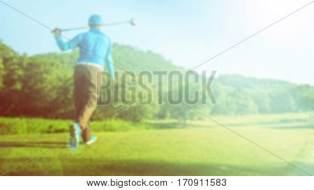Image of blur golf players on course