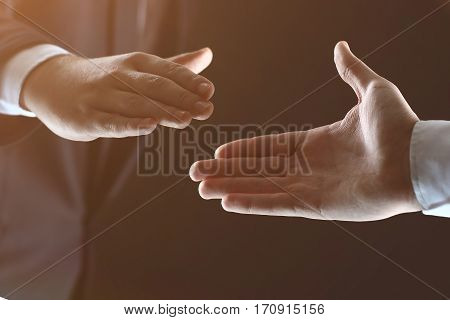 Business people shaking hands close-up finishing up a meeting