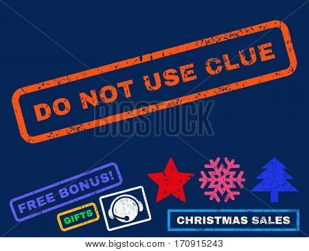 Do Not Use Clue text rubber seal stamp watermark with additional bonus christmas symbols. Caption inside rectangular shape with grunge design and scratched texture.