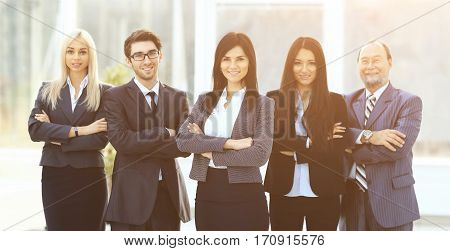 Girl director and business team on office background on a sunny day
