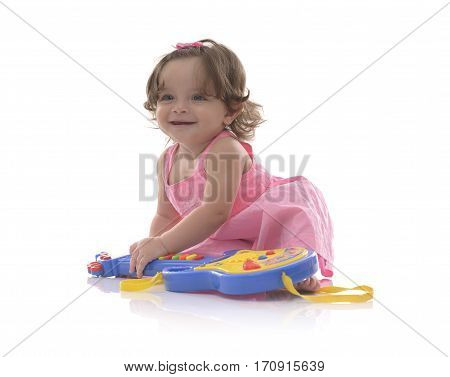 Beautiful Innocent Girl With Toy Guitar