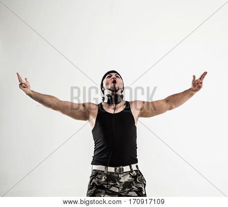 rapper with headphones takes breakdancing. photo on a white background and has an empty space for your text