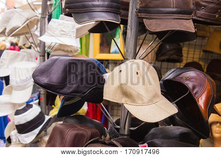 Collection Of Colorful Hats And Caps On Stall At The Bazaar
