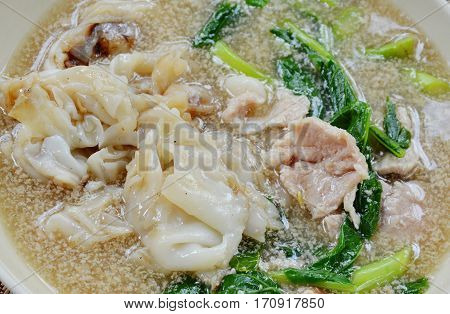 stir fried rice noodle with pork in gravy sauce on dish