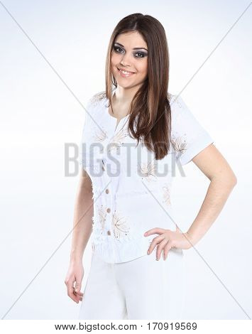 portrait of beautiful female model in a white pantsuit over a white background