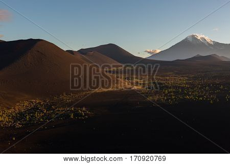 Volcanoes and Dead wood at dawn - consequence of a catastrophic release of ash during the eruption of the volcano in 1975 Tolbachik north breakthrough