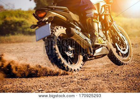 man extreme riding touring enduro motorcycle on dirt field