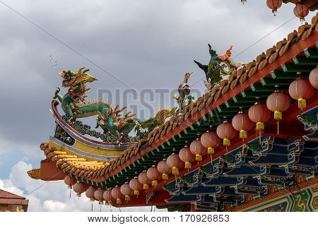 Dragon and Crane Mythical Creatures on Chinese Temple Roof Top