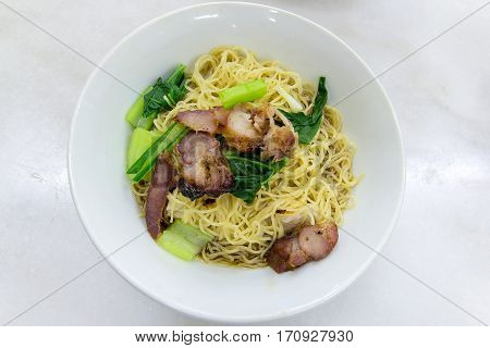 Char Siew Barbecue Pork Wanton Noodles with green vegetable dried version closeup macro
