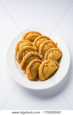 Gujiya - sweet dumplings made during the festival of holi and diwali, selective focus