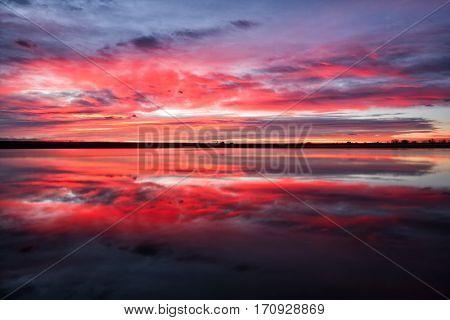 Goregous colorful sunrise on a lake in Colorado
